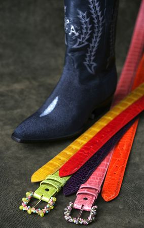 tooled: western colorful belts and a cowboy boot