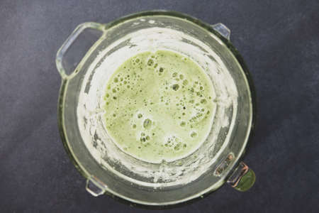 Healthy Beverage Green Smoothie in Glass Blender Top View