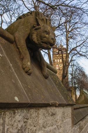 cardiff: The walls of Cardiff Castle - Hyena statue - Cardiff, Wales, UK