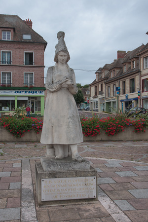reputed: VIMOUTIERS, FRANCE, SEPTEMBER 18  The statue of Marie Harel in Vimoutiers on September 18th 2012  Madame Marie Harel is reputed to have invented the famous camembert cheese