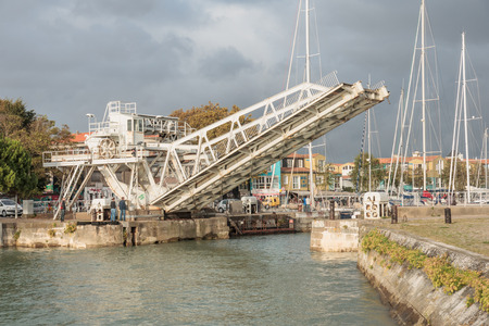 moveable: LA ROCHELLE, FRANCE - OCTOBER 02, 2012  Moveable Bridge at the entry of the old port in La Rochelle, France  La Rochelle is a city in western France and a seaport on the Bay of Biscay