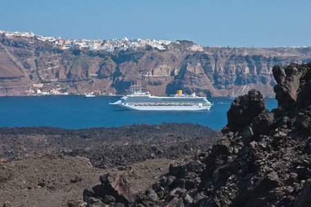 fira: Volcanic rock  basalt  and the town of Fira, Santorini, Greece Stock Photo