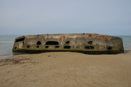 basse normandy: Remains of Mulberry Harbor at Arromanches, Normandy, France  Stock Photo
