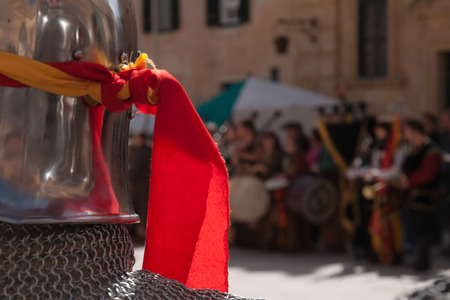sword act: MDINA, MALTA - APRIL 14  Historic battle reenactment in the Medieval Mdina festival in Mdina, Malta on April 14, 2012