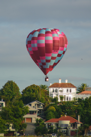 nz: HAMILTON, NZ - MARCH 28, 2010  Hot Air Balloons flying above Lake Rotoroa  Hamilton Lake Domain , in Hamilton, New Zealand  This is part of the Balloons over Waikato event