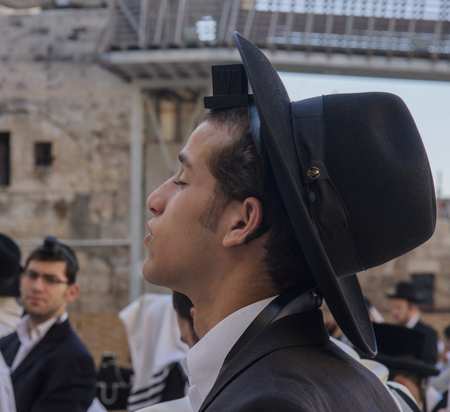 tefillin: JERUSALEM - JULY 31 - Orthodox Jews prays at the Western Wall - July 31, 2013 in the old city of Jerusalem, Israel  The western wall is the holiest place in Jewish tradition
