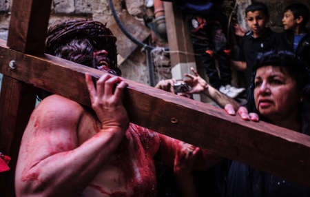 JERUSALEM-MARCH 29  Catholic Good Friday - a group of actors presenting the crucifixion of Christ near Church of the Holy Sepulchre in Old City, Good Friday March 29, 2013 in Jerusalem, Israel