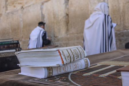 JERUSALEM - JULY 31 - Orthodox Jews prays at the Western Wall, behind praying book  Siddur  - July 31, 2013 in the old city of Jerusalem, Israel  This is the holiest place in Jewish tradition Redakční