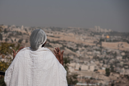 JERUSALEM - OCT 31  Ethiopian Jewish woman prays, facing the old city, at the Sigd - Oct  31, 2013 in Jerusalem, Israel  The Sigd is an annual holyday of the Ethiopian Jews