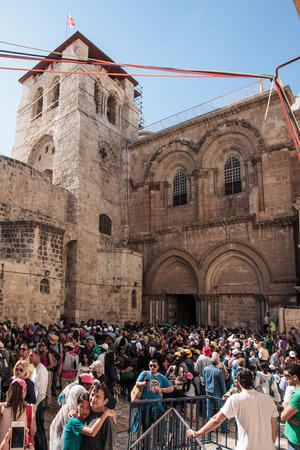 JERUSALEM - APRIL 18, 2014  A crowd of pilgrims fills the front yard of the Church of the Holy Sepulcher, on Good Friday, in the old city of Jerusalem, Israel