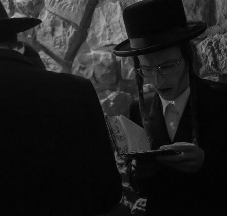 rabbi: MERON, ISRAEL - MAY 18, 2014  An orthodox Jew prays at the annual hillulah of Rabbi Shimon Bar Yochai, in Meron, on Lag BaOmer Holiday  This is an annual celebration at the tomb of Rabbi Shimon