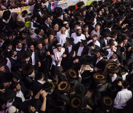 rabbi: MERON, ISRAEL - MAY 18, 2014  Orthodox Jews dance at the annual hillulah of Rabbi Shimon Bar Yochai, in Meron, on Lag BaOmer Holiday  This is an annual celebration at the tomb of Rabbi Shimon Editorial