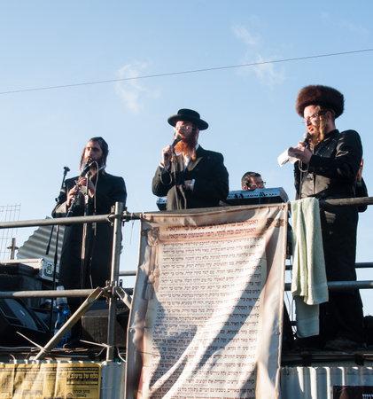 rabbi: MERON, ISRAEL - MAY 18, 2014  Orthodox Jews play music and sing to the dancing crowd at the annual hillulah of Rabbi Shimon Bar Yochai, in Meron, on Lag BaOmer Holiday