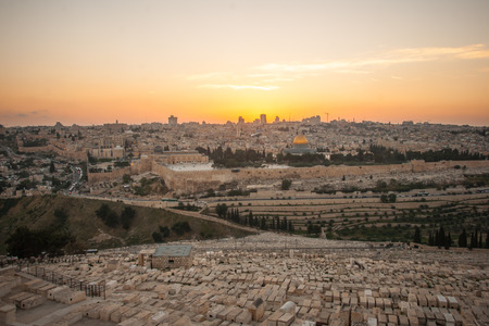 A view of the old city of Jerusalem at sunset from the Mount of Olives, in Jerusalem, Israel photo