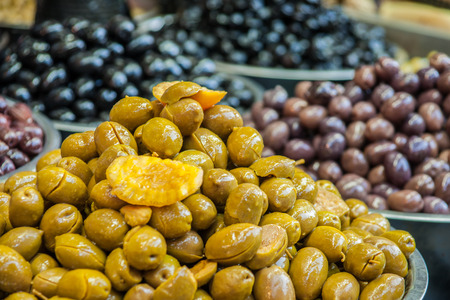 Various olives on sale in the market photo