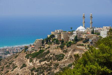 The Kababir neighborhood and the Mahmood Mosque, with the Mediterranean sea in the background  Haifa, Israel photo