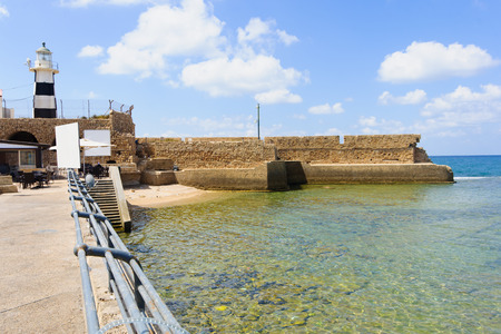 The lighthouse and an old Templars crusader fort in the old city of Acre, Israel photo