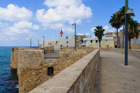 acre: St  John the Baptist Franciscan church and the sea wall promenade, in the old city of Acre, Israel
