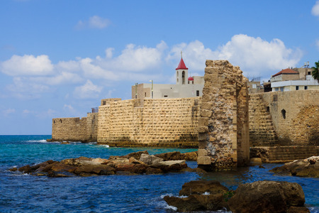 acre: The sea wall and St  John the Baptist Franciscan church, in the old city of Acre, Israel