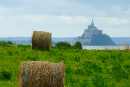 mont saint michel: Harvest straw bales, in front of Le Mont Saint Michel monastery. Normandy, France Stock Photo