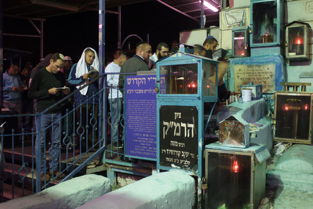 selichot: SAFED, ISRAEL - OCTOBER 03, 2014: Jewish men pray Selichot (request for forgiveness) at the tomb of The ARI (Rabbi Isaac Luria), on Yom Kippur eve, in Safed, Israel. Editorial