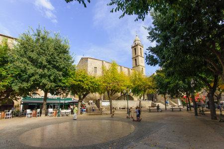 SARTENE, FRANCE - OCTOBER 12, 2014: Scene of Place Porta square (or Place de la Liberation) in Sartene, Corsica, France. This is the main square of Sartene