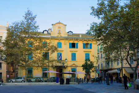 BASTIA, FRANCE - OCTOBER 16, 2014: The Hotel De Ville (city hall) and the place du Marche square, in Bastia, Corsica, France. Bastia is the biggest city in Corsica