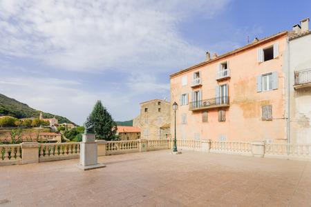 Scene of Place Porta square (or Place de la Liberation) in Sartene, Corsica, France photo