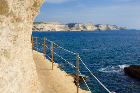 The Stairway of the King of Aragon (lower part) and view of the cliffs, in Bonifacio, Corsica, France photo