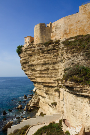 The cliffs, buildings, and city wall, in Bonifacio, Corsica, France photo