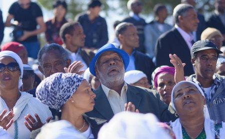 holiday prayer book: JERUSALEM - NOV 20, 2014: Ethiopian Jewish men and women pray at the Sigd, in Jerusalem, Israel. The Sigd is an annual holiday of the Ethiopian Jews