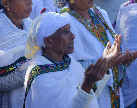 JERUSALEM - NOV 20, 2014: Ethiopian Jewish women pray at the Sigd, in Jerusalem, Israel. The Sigd is an annual holiday of the Ethiopian Jews
