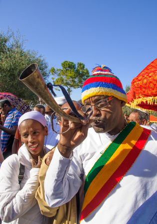 JERUSALEM - NOV 20, 2014: A Kes, religious leader of the Ethiopian Jews, plays a shofar to mark the end of the Sigd prays, in Jerusalem, Israel. The Sigd is an annual holiday of the Ethiopian Jews