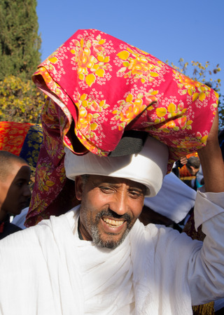 holiday prayer book: JERUSALEM - NOV 20, 2014: A Kes, religious leader of the Ethiopian Jews, carrying a wrapped holy prayer book, at the end of the annual Sigd holiday prays, in Jerusalem, Israel Editorial