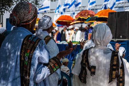 JERUSALEM - OCT 31, 2013: Ethiopian Jewish women pray in front of the Kessim at the Sigd in Jerusalem, Israel. The Sigd is an annual holiday of the Ethiopian Jews. Editorial