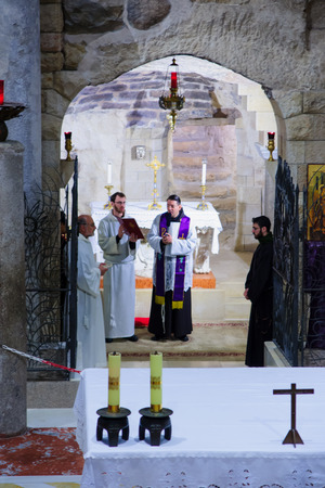 nazareth: NAZARETH, ISRAEL - December 19, 2014: Praying ceremony in the Church of Annunciation, in Nazareth, Israel Editorial