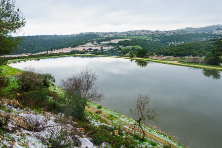 galilee: Water reservoir on a rare snowy day, in upper galilee, northern Israel