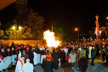 patron: MONTE CARLO, MONACO - JAN 26, 2015: People attend the symbolic burning of a boat, as part of the annual Saint Devota celebration, in Monte Carlo, Monaco. Saint Devota is the patron of Monaco