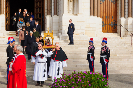 patron of europe: MONACO-VILLE, MONACO - JAN 27, 2015: The relics of Saint Devota are being carried out of the cathedral to the streets, as part of the annual Saint Devota celebration, in Monaco-Ville, Monaco Editorial