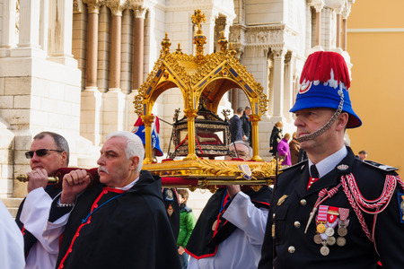 carried: MONACO-VILLE, MONACO - JAN 27, 2015: The relics of Saint Devota are being carried out of the cathedral to the streets, as part of the annual Saint Devota celebration, in Monaco-Ville, Monaco Editorial