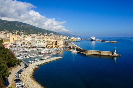 Scene of the old port (the Vieux Port) and the commercial port, in Bastia, Corsica, France.