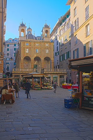 pietro: GENOA, ITALY - JAN 24, 2015: Scene of Piazza Banchi and San Pietro church, with shops, local and tourists, in Genoa, Liguria, Italy