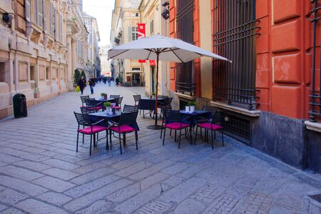 garibaldi: GENOA, ITALY - JAN 24, 2015: Scene of Garibaldi Street, with cafe tables, local and tourists, in Genoa, Liguria, Italy Editorial