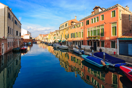 canal street: VENICE, ITALY - FEB 02, 2015: Typical canal and street scene, with local and tourists, in Cannaregio, Venice, Veneto, Italy
