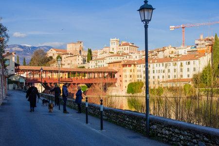 vechio: BASSANO DEL GRAPPA, ITALY - JAN 31, 2015: Scene of The Ponte Vecchio (or Ponte degli Alpini) bridge, with local and tourists, and the Brenta river, in Bassano del Grappa, Veneto, Italy