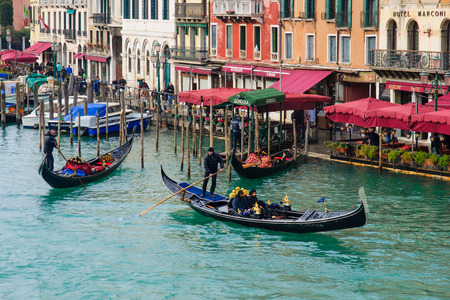 gondoliers: VENICE, ITALY - FEB 03, 2015: Typical canal scene of gondolas and gondoliers, in Venice, Veneto, Italy Editorial