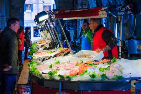 the merchant of venice: VENICE, ITALY - FEB 03, 2015: Market scene with sellers and shoppers in the rialto market, in Venice, Veneto, Italy