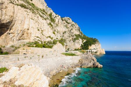 Road ss1 and the coast, near Noli, in Liguria, Italy