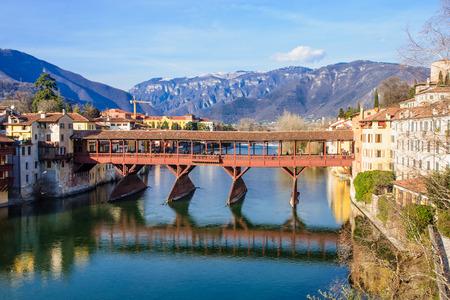 The Ponte Vecchio (or Ponte degli Alpini) bridge, and the Brenta river, in Bassano del Grappa, Veneto, Italy Stock Photo