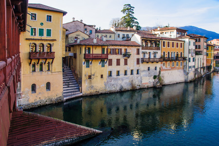 The Ponte Vecchio (or Ponte degli Alpini) bridge, and colorful houses on the Brenta river, in Bassano del Grappa, Veneto, Italy